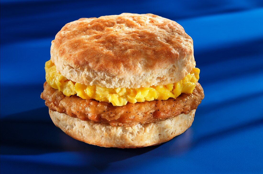 Pork and scrambled eggs on an American biscuit