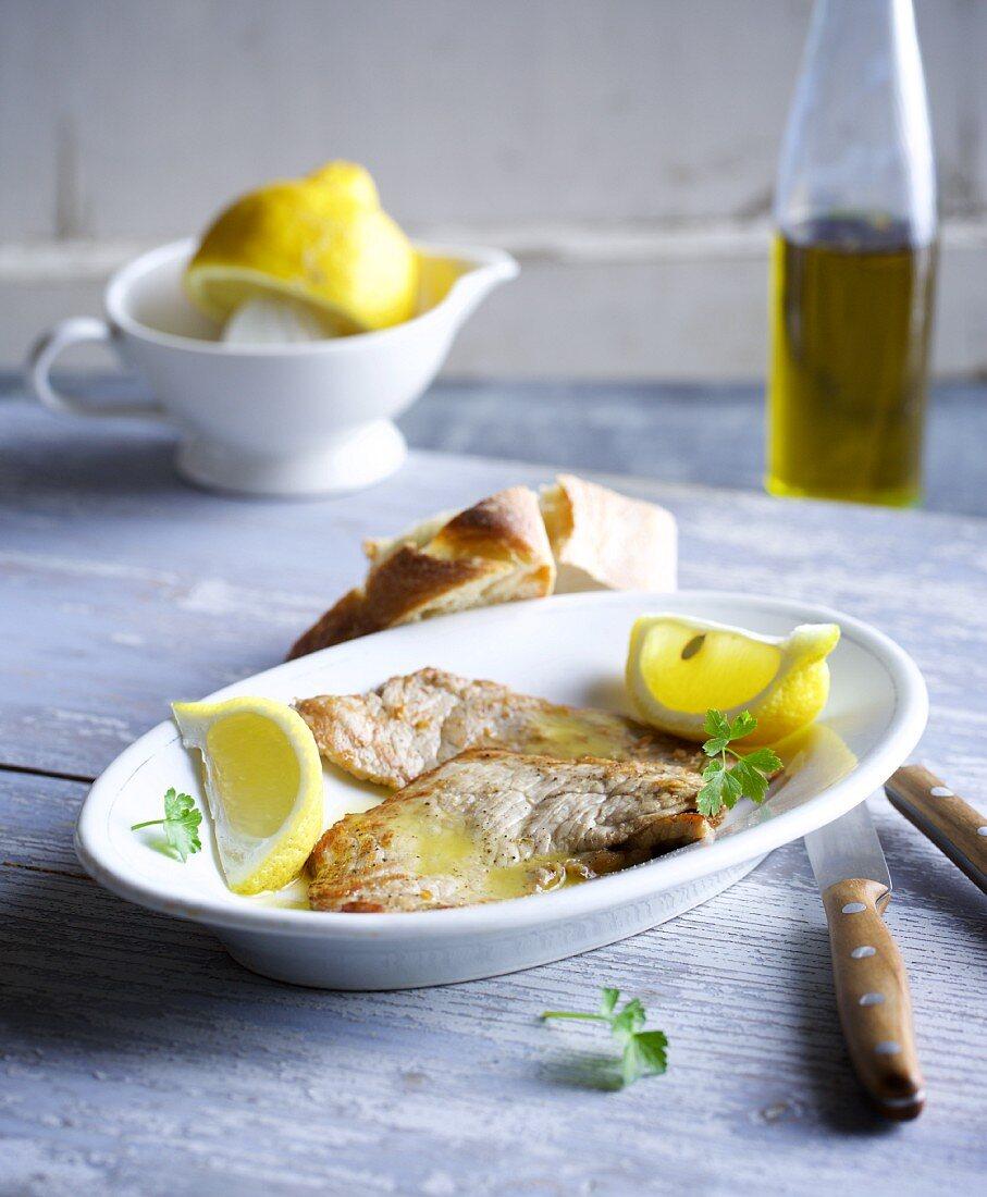 Scaloppine al limone (veal escalope in a lemon sauce, Italy)