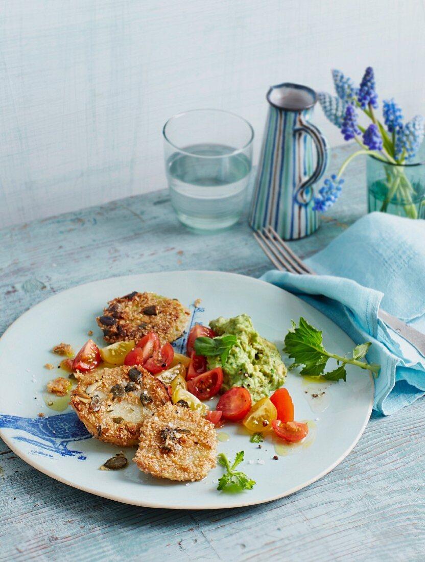 Vegetarian kohlrabi escalope with avocado cream and tomatoes