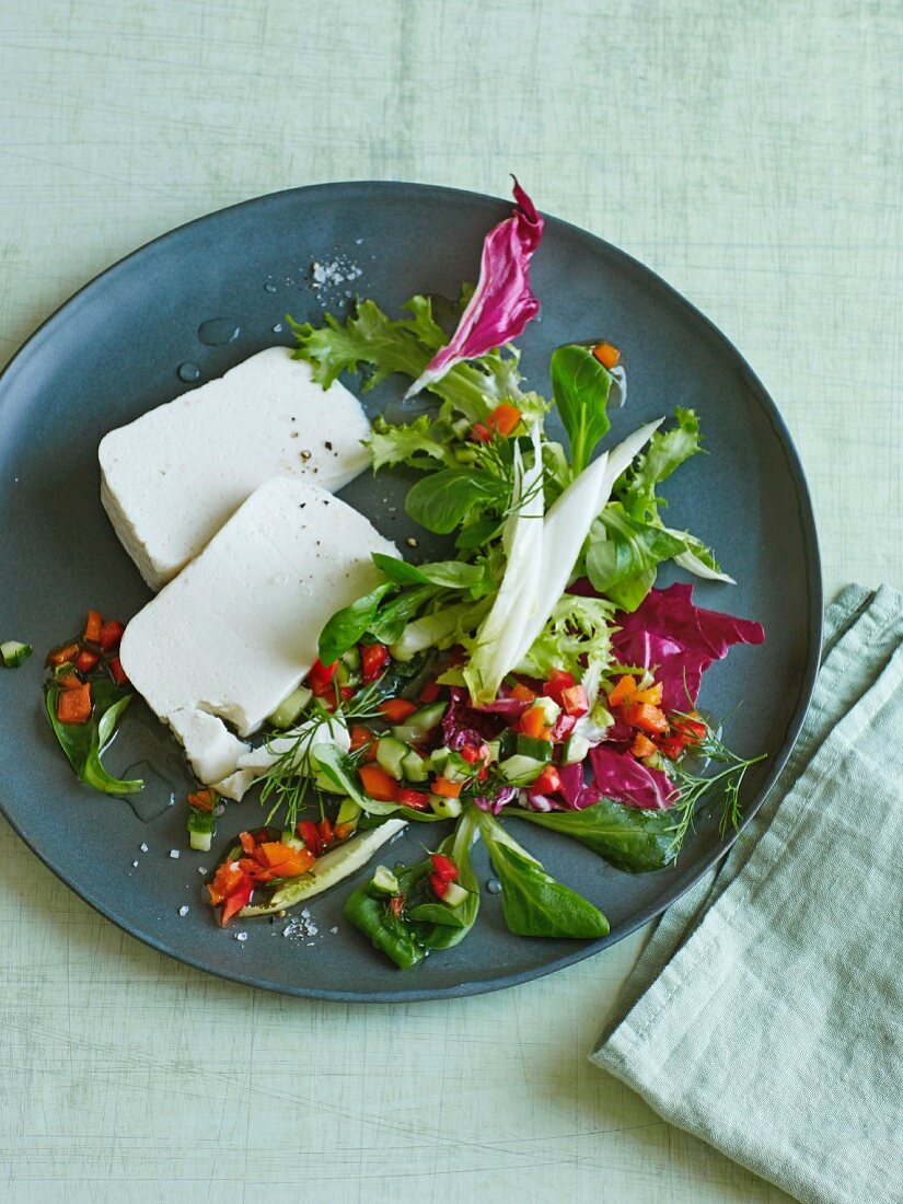 Horseradish and goat's cream cheese mousse with a colourful mixed leaf salad