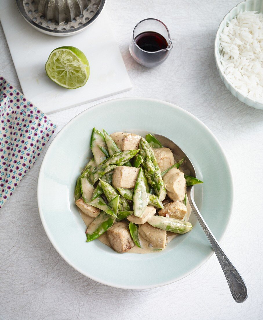 Stir-fried chicken and coconut with mange tout and green asparagus