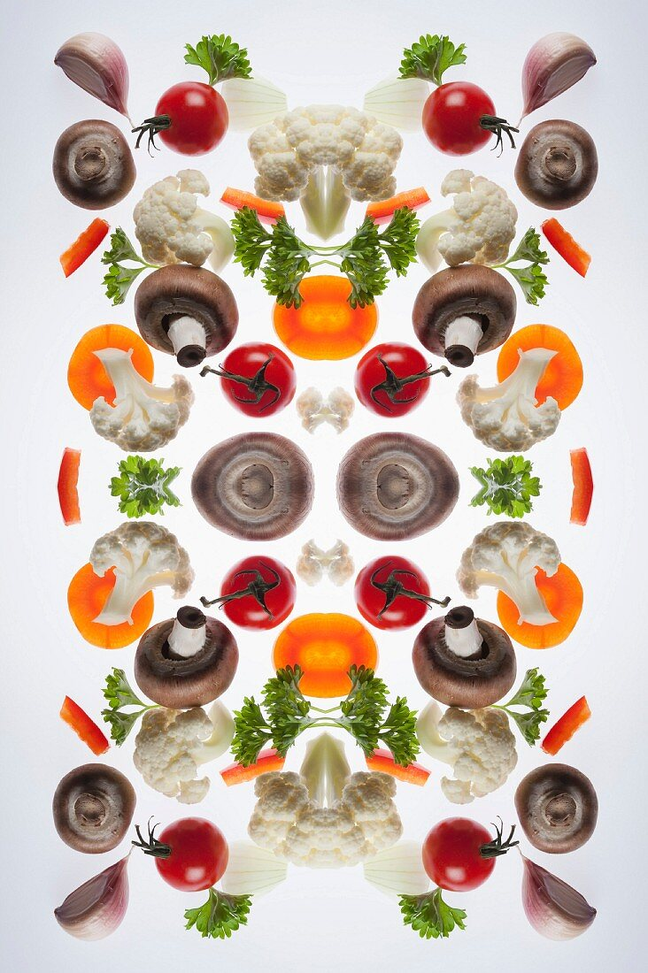 A digital composition of mirrored images of mixed vegetables
