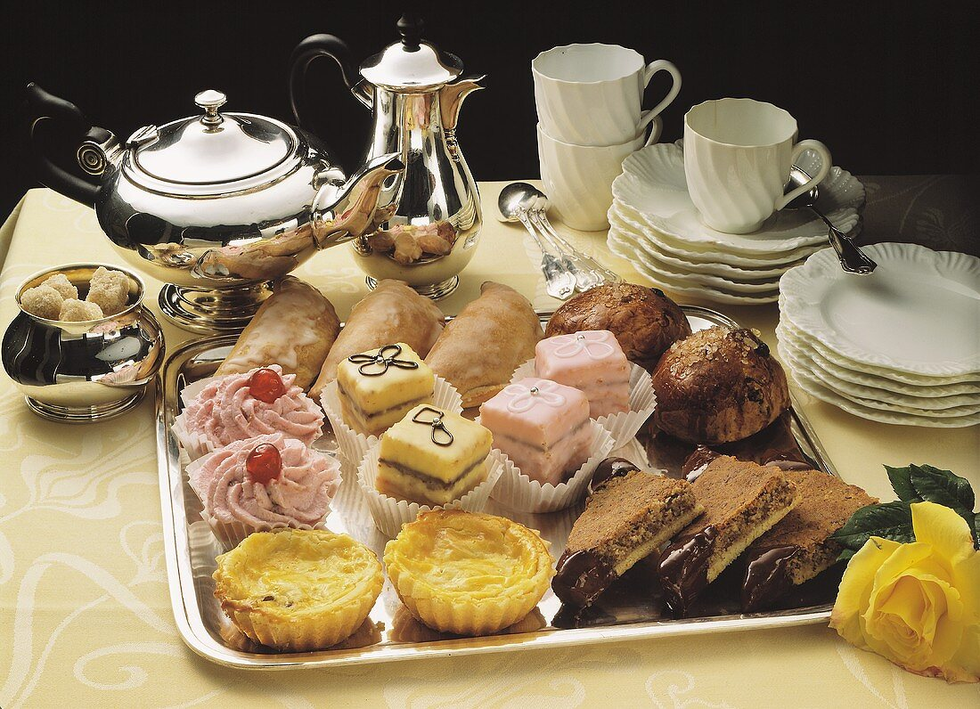 Various tea cakes & petit fours on silver tray