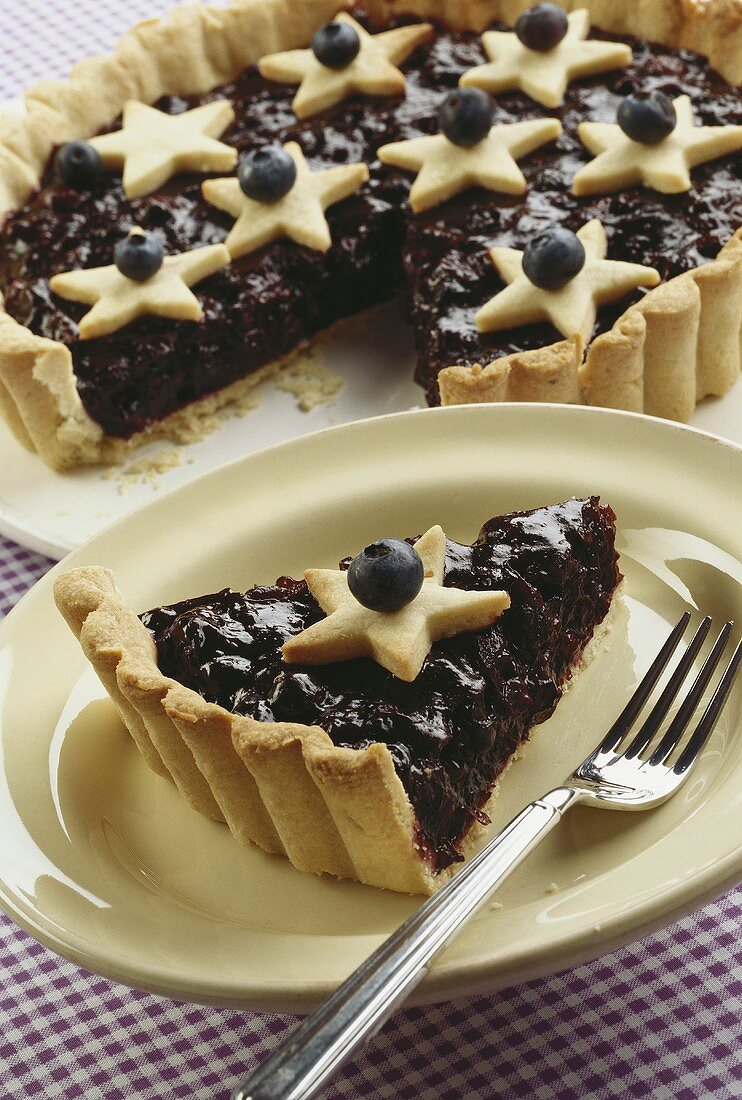 Blueberry tart decorated with pastry stars