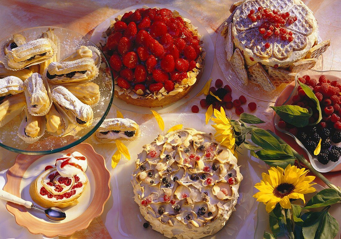 Various cakes, gateaux and small cakes with berries