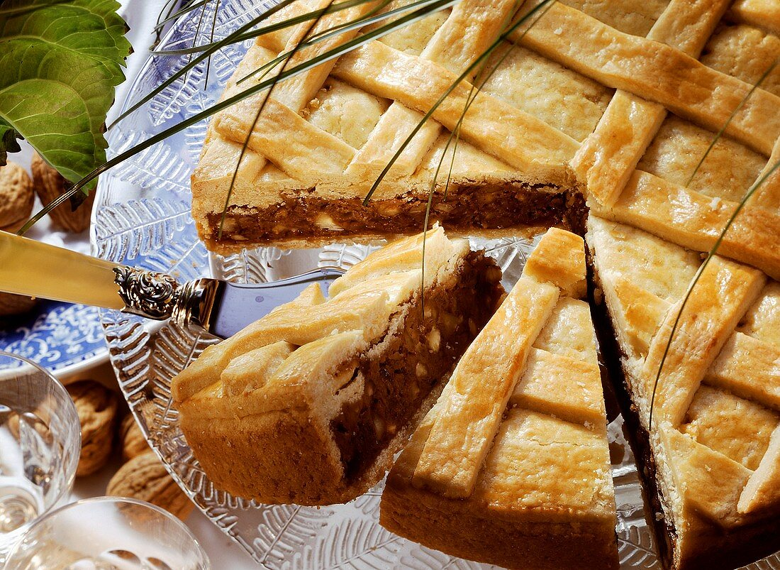 Engadiner nut torte on cake plate, pieces cut