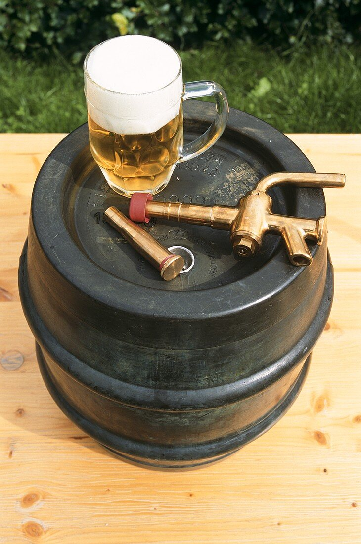Beer barrel with tap and tankard
