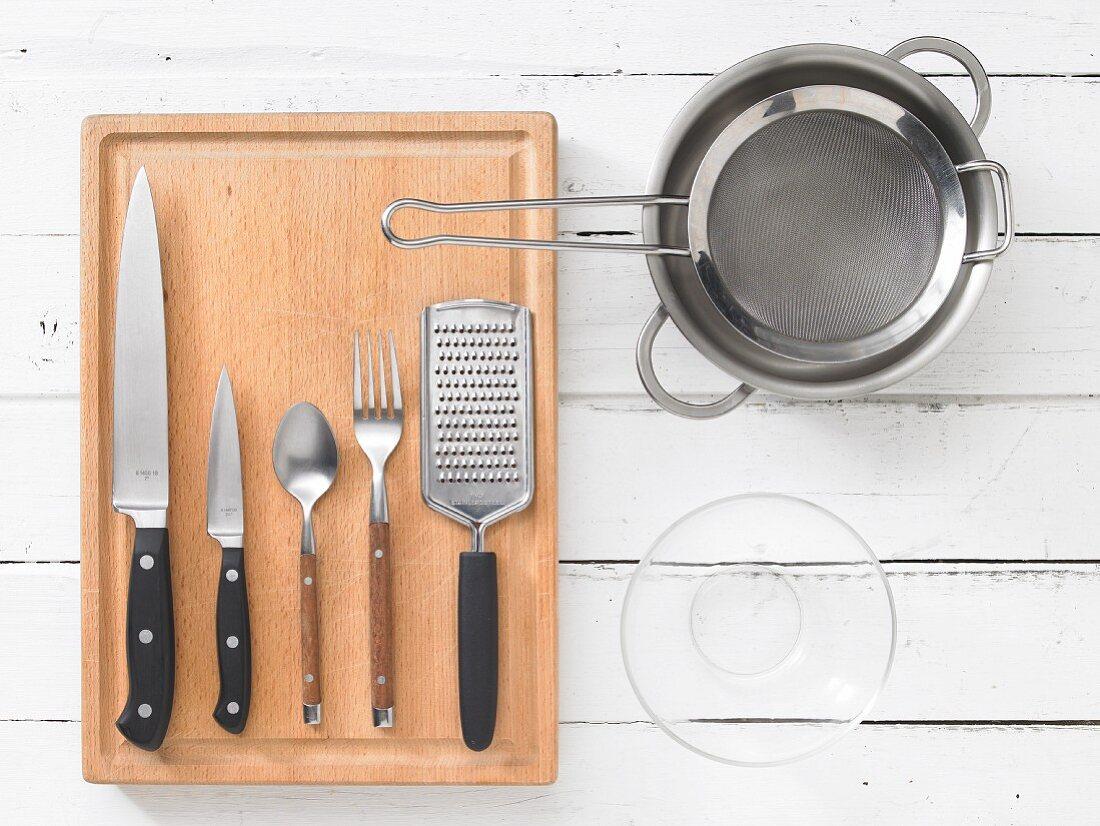 Kitchen utensils for preparing fish and potatoes