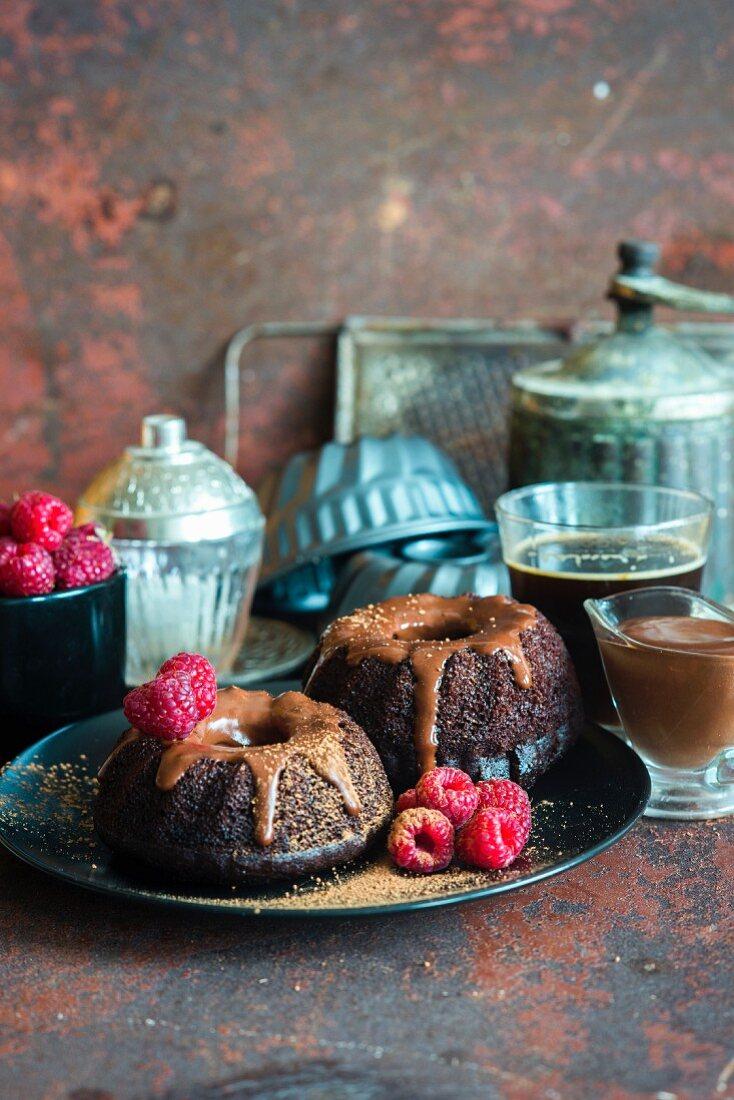 Mini chocolate bundt cakes with chocolate sour cream icing with fresh raspberries