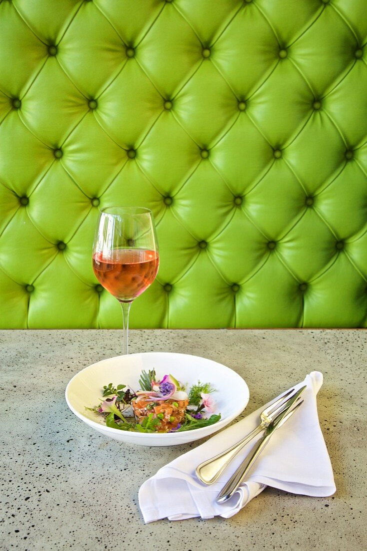 Salmon tartare with leaf salad and edible flowers