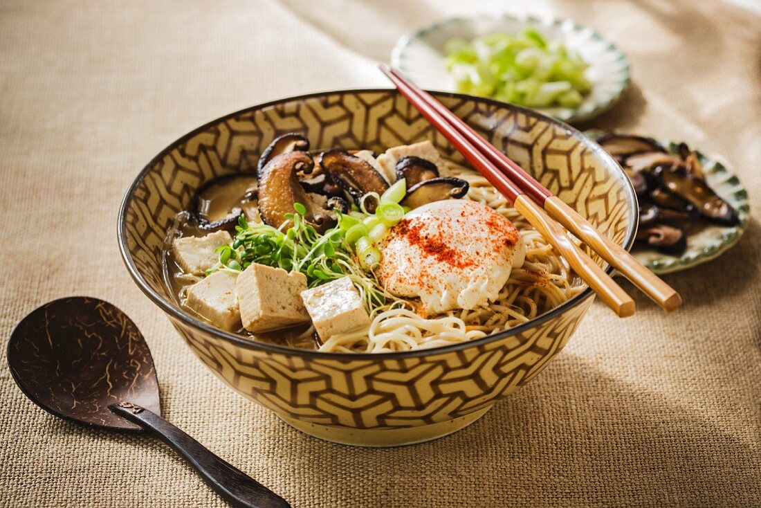 Japanese mapo tofu ramen soup with mushrooms and poached egg
