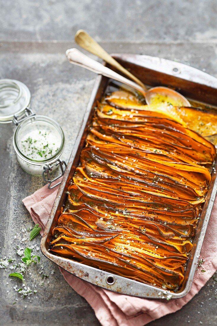 Crispy sweet potato slices with oregano salt