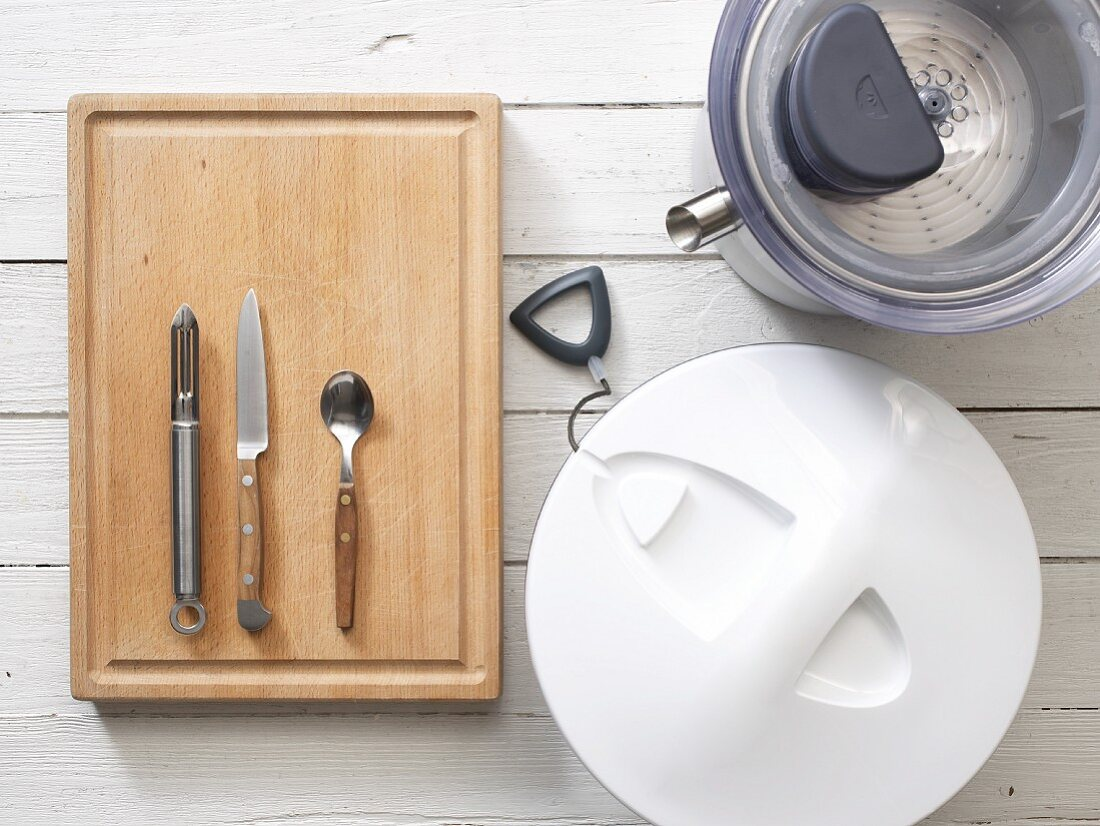 Kitchen utensils: a juicer, salad spinner, peeler, knife and spoon