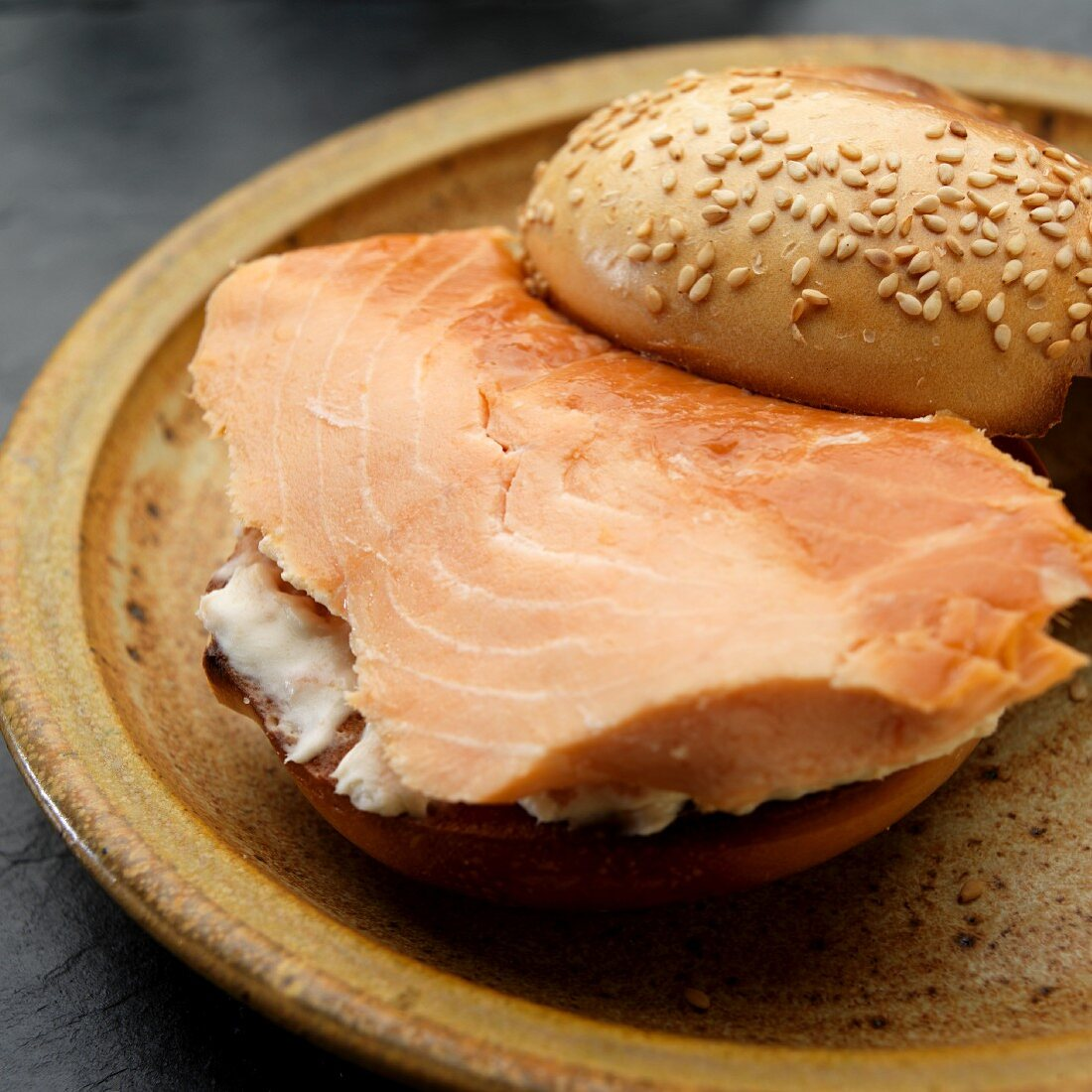 Sesame bagel filled with smoked salmon