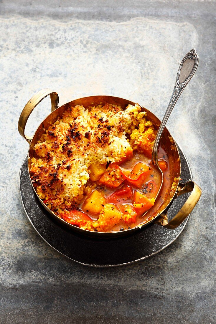 Asian sweet potato curry with pineapple, tomato and a coconut crust