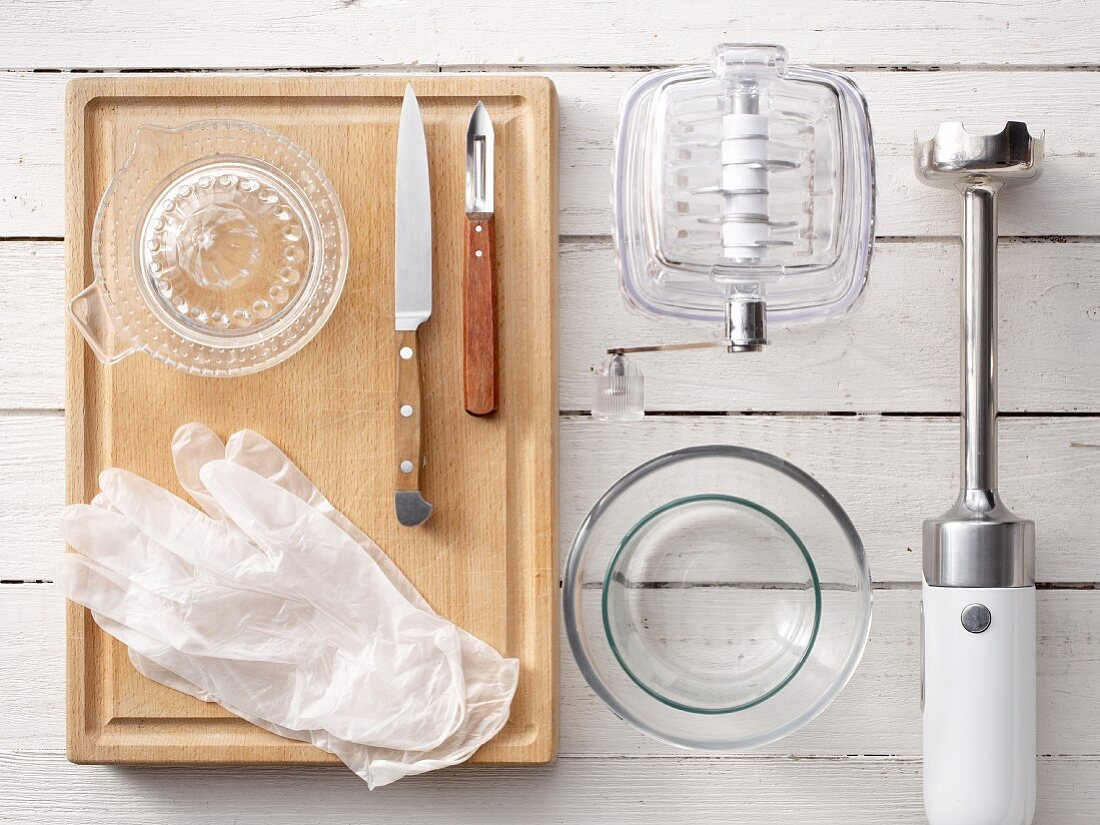 Kitchen utensils: an ice crusher, hand blender, disposable gloves and a citrus press