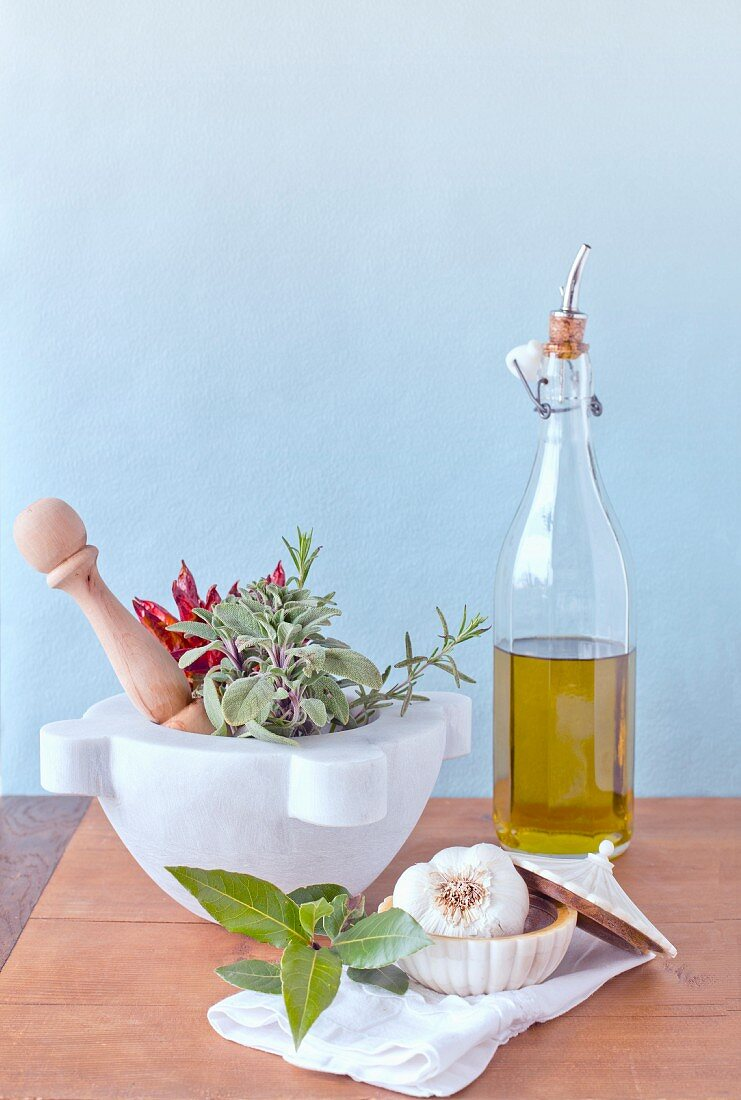 An Italian pestle and mortar from Carrara, Tuscany, with chilli peppers, sage, olive oil and garlic