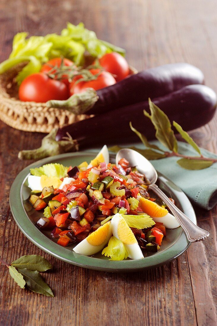 Spanish-style vegetable salad with aubergine and egg