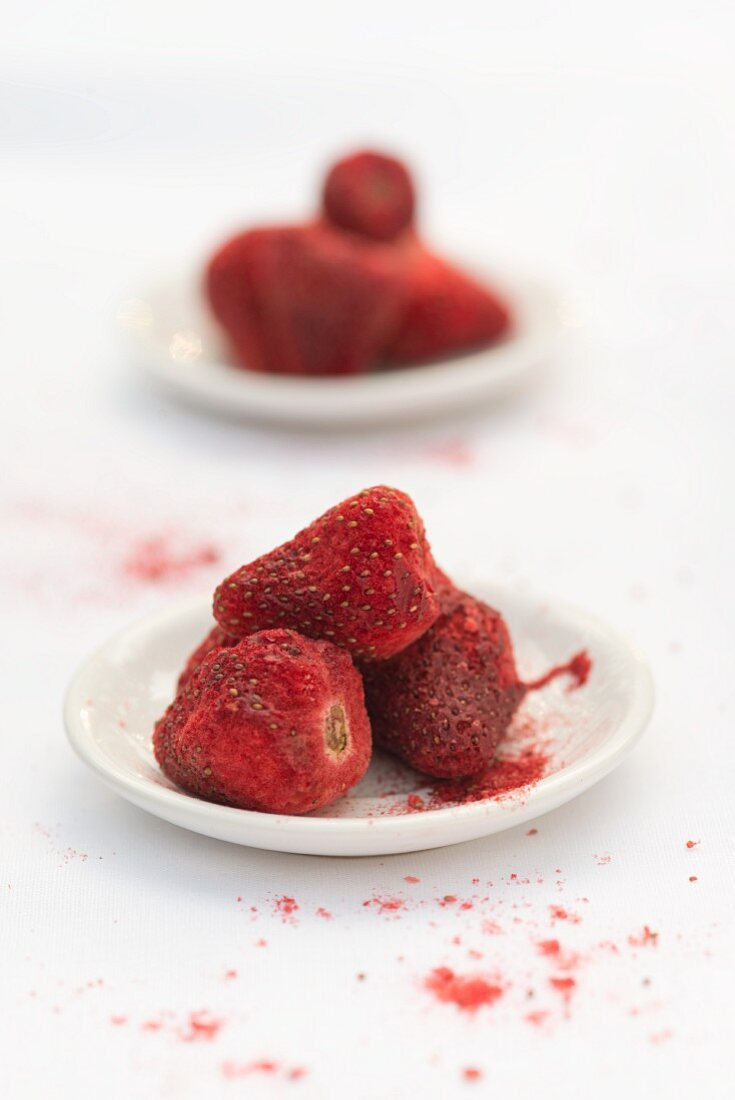 Freeze-dried strawberries on small plates