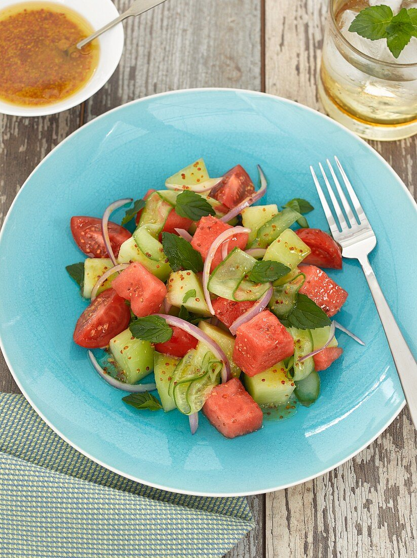 A summer salad with cucumber, tomato and watermelon