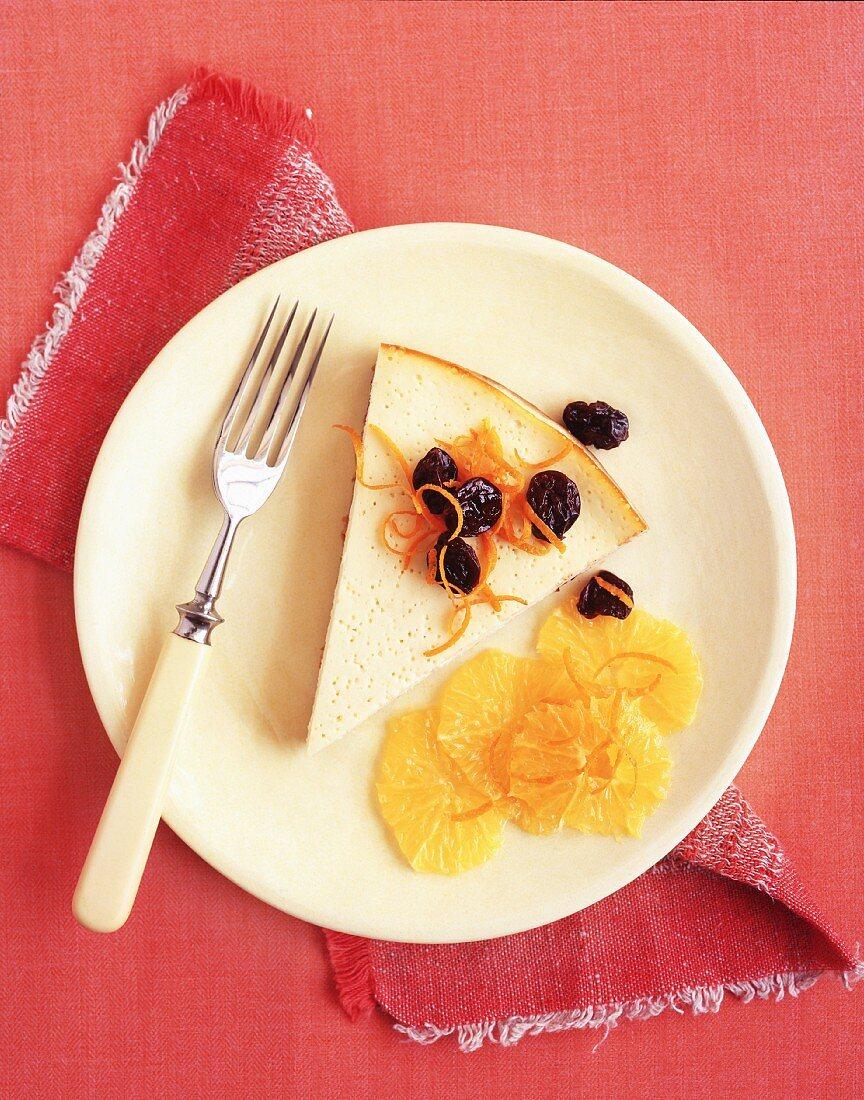 A slice of custard tart with citrus fruits