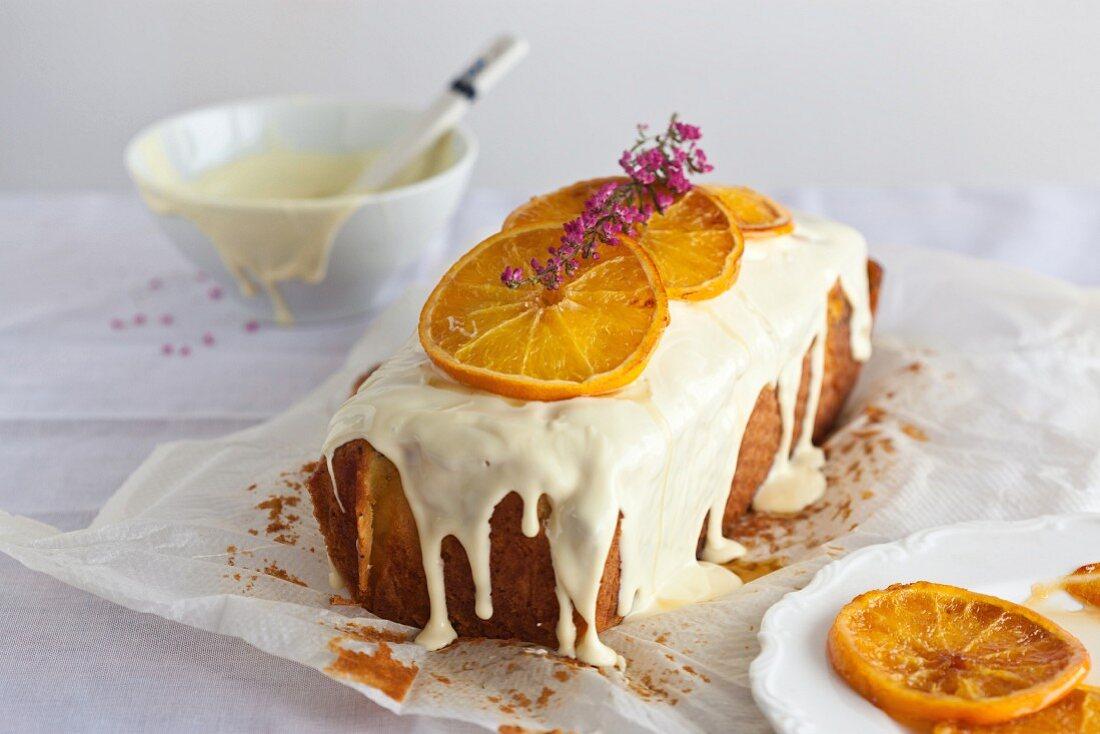 Orange cake with poppy seeds and white chocolate icing