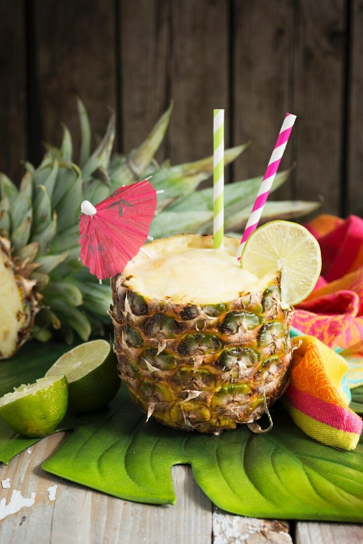 Pineapple smoothie with green tea, ginger and lime in a hollowed pineapple
