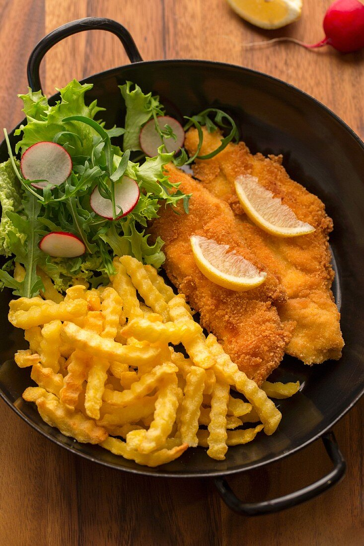 Gluten-free chicken escalopes in breadcrumbs with chips and salad