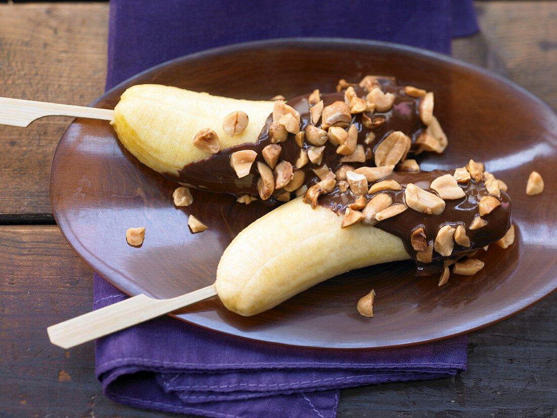 Baby banana skewers with a chocolate and peanut glaze