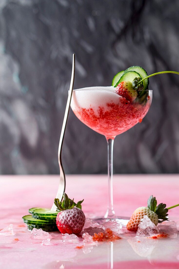 Strawberry slush with melon and pepper decorated with cucumber and frozen strawberries