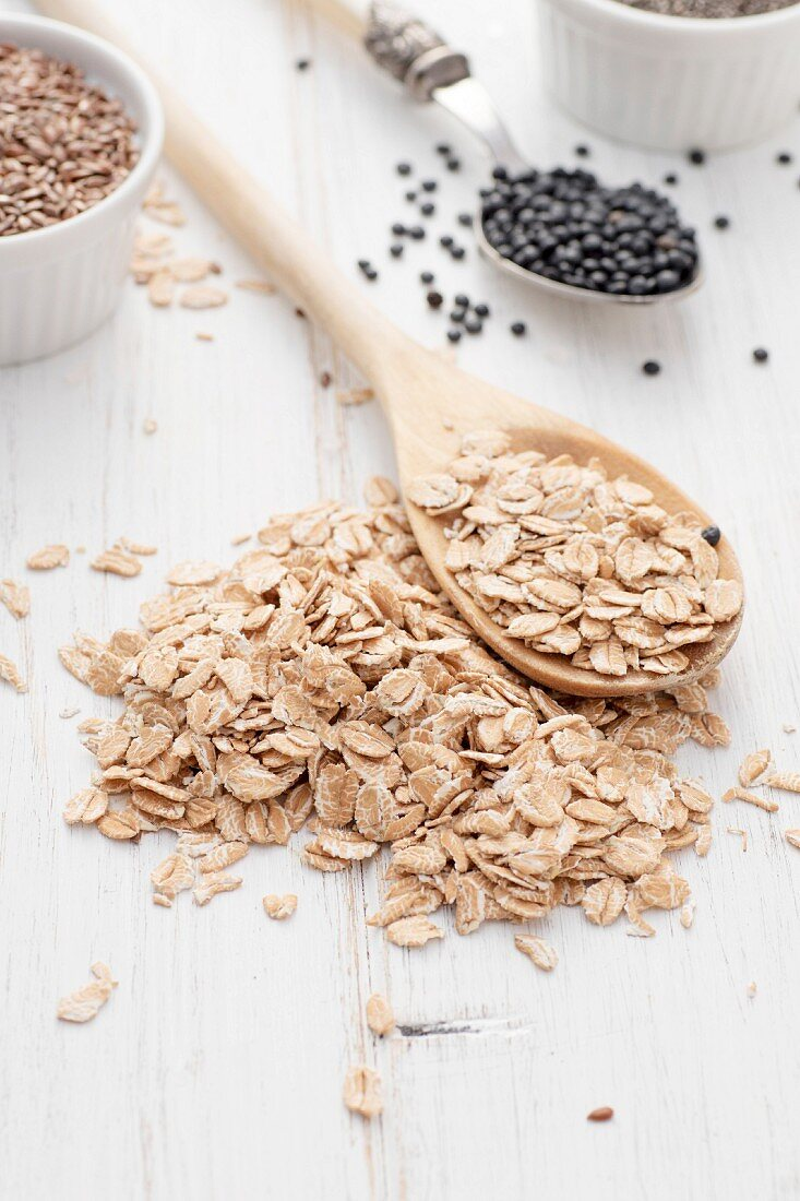 Rolled oats on wooden spoon
