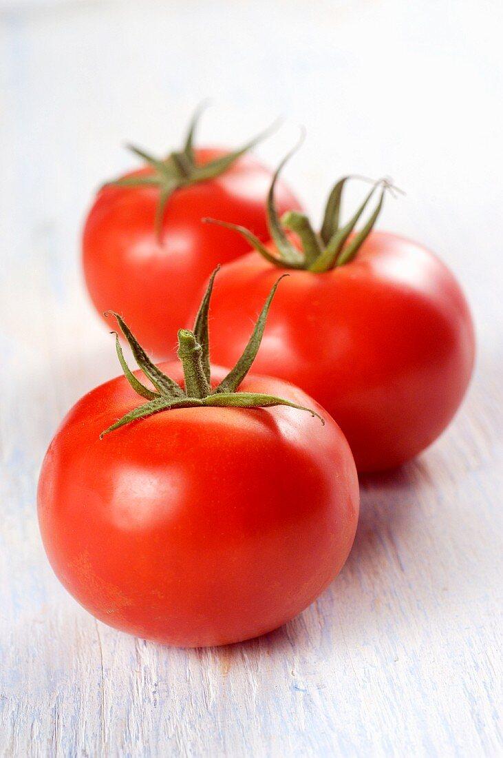 Three Vine Ripe Tomatoes on White