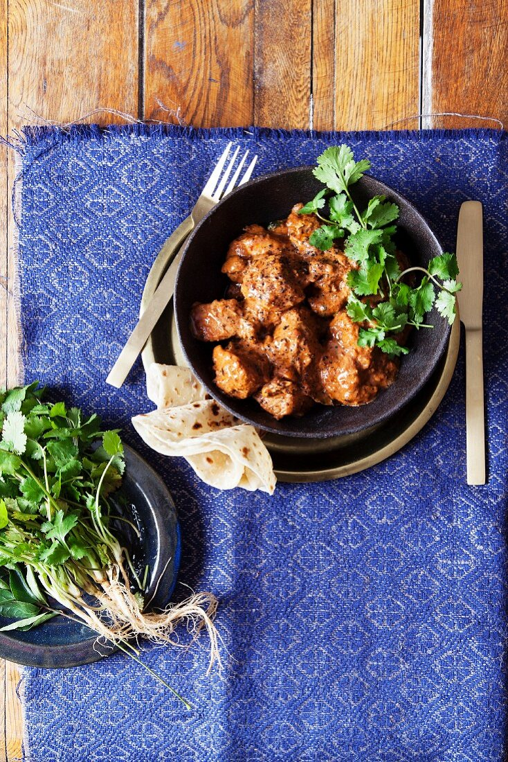 Indian madras curry with chicken and roti bread