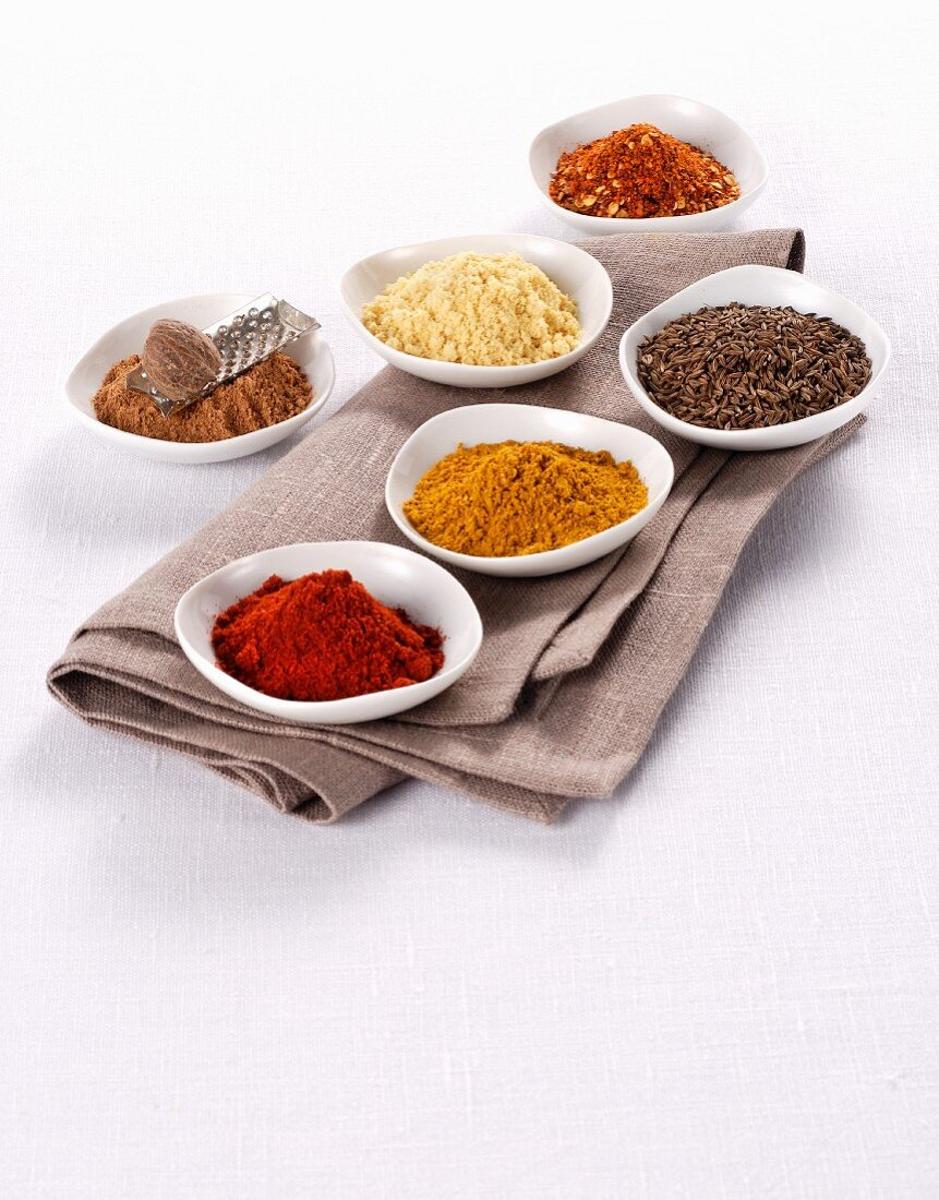 Assorted spices in small containers
