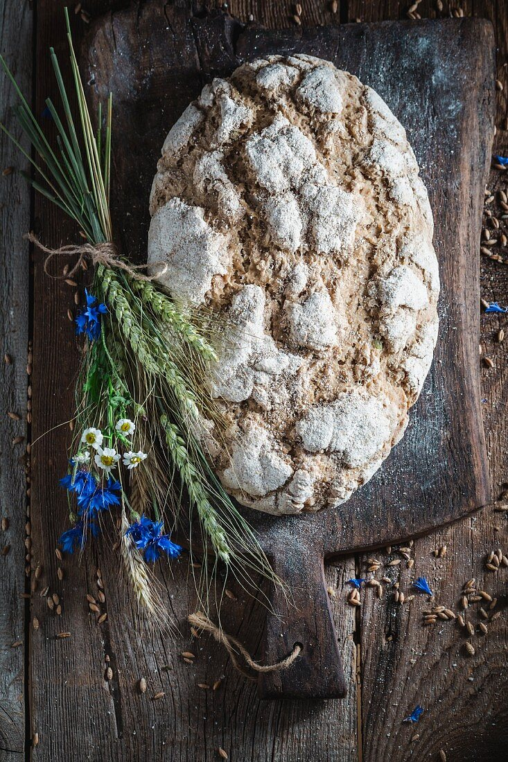 Wholemeal bread on an old wooden table