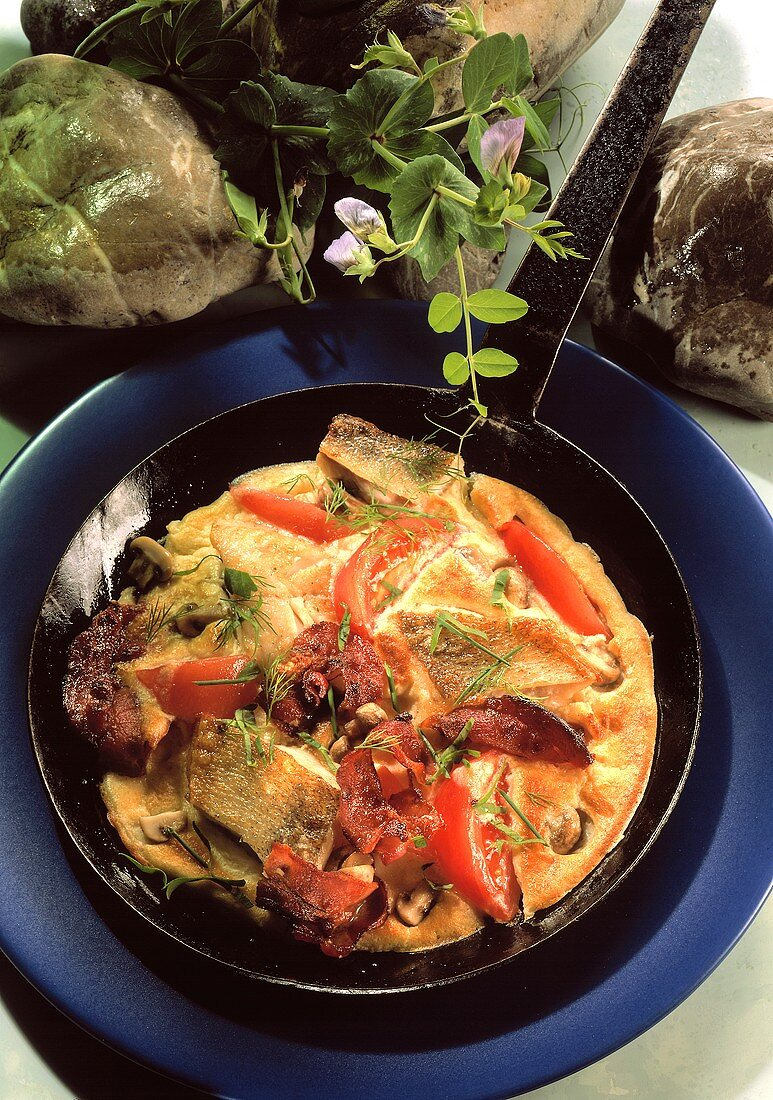 Pike-perch Omelet with Bacon, Tomatoes and Herbs in Cast-iron Frying Pan