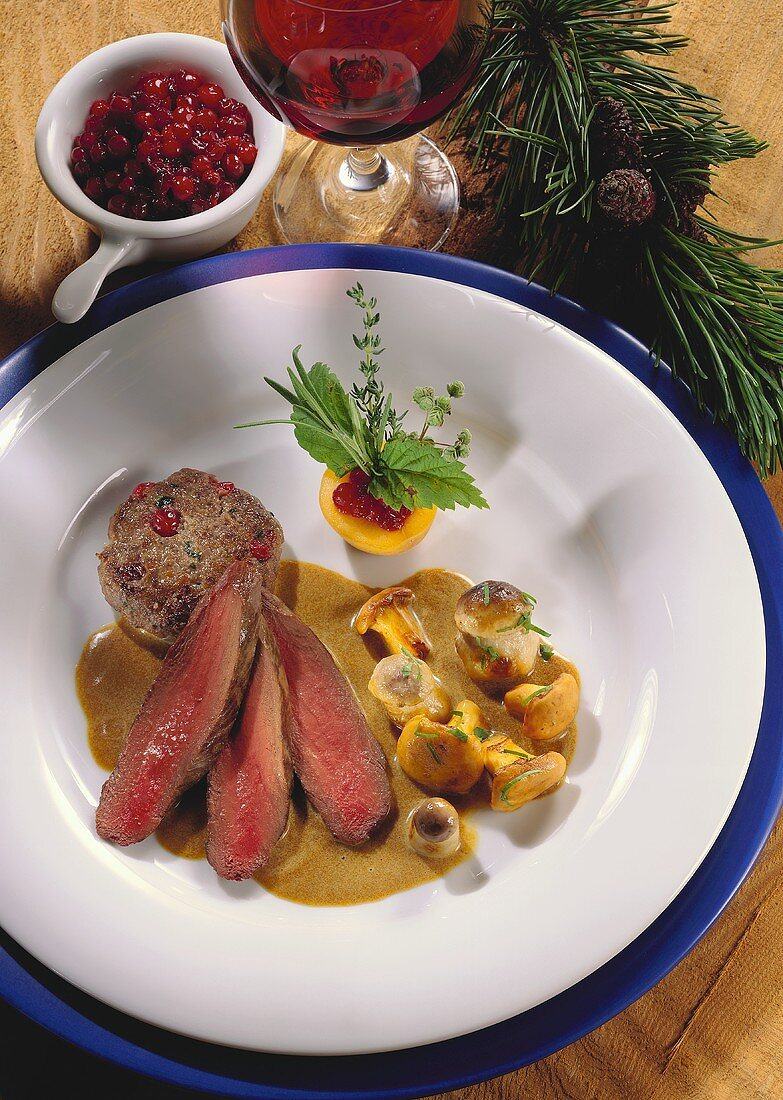 Three slices of roasted venison with mushrooms