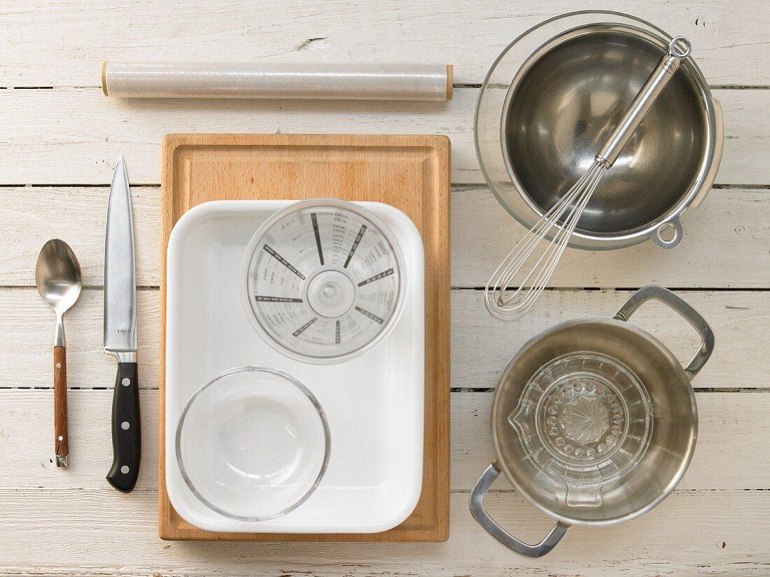 Kitchen utensils for making grapefruit cream slices with sponge biscuits