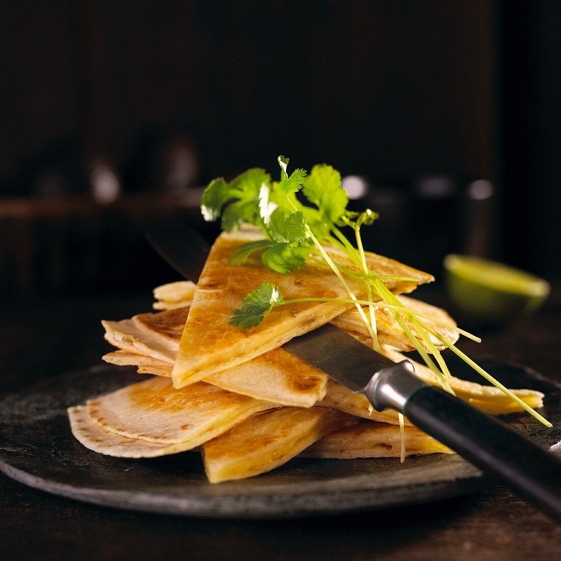 A stack of quesadillas garnished with coriander (Mexico)