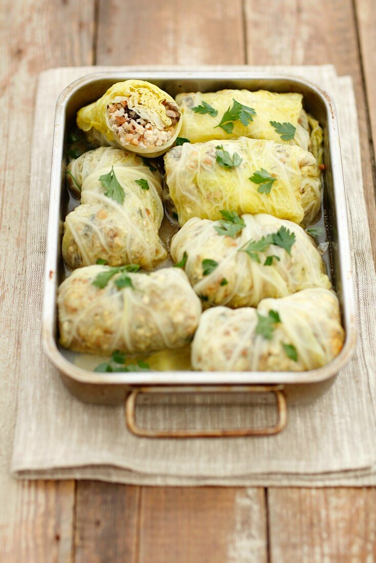 Savoy cabbage roulades stuffed with chicken, feta, buckwheat and barley