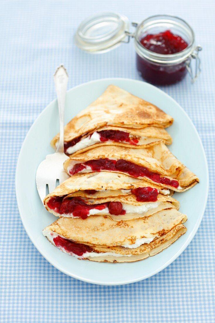 Pancakes with cherry jam and quark