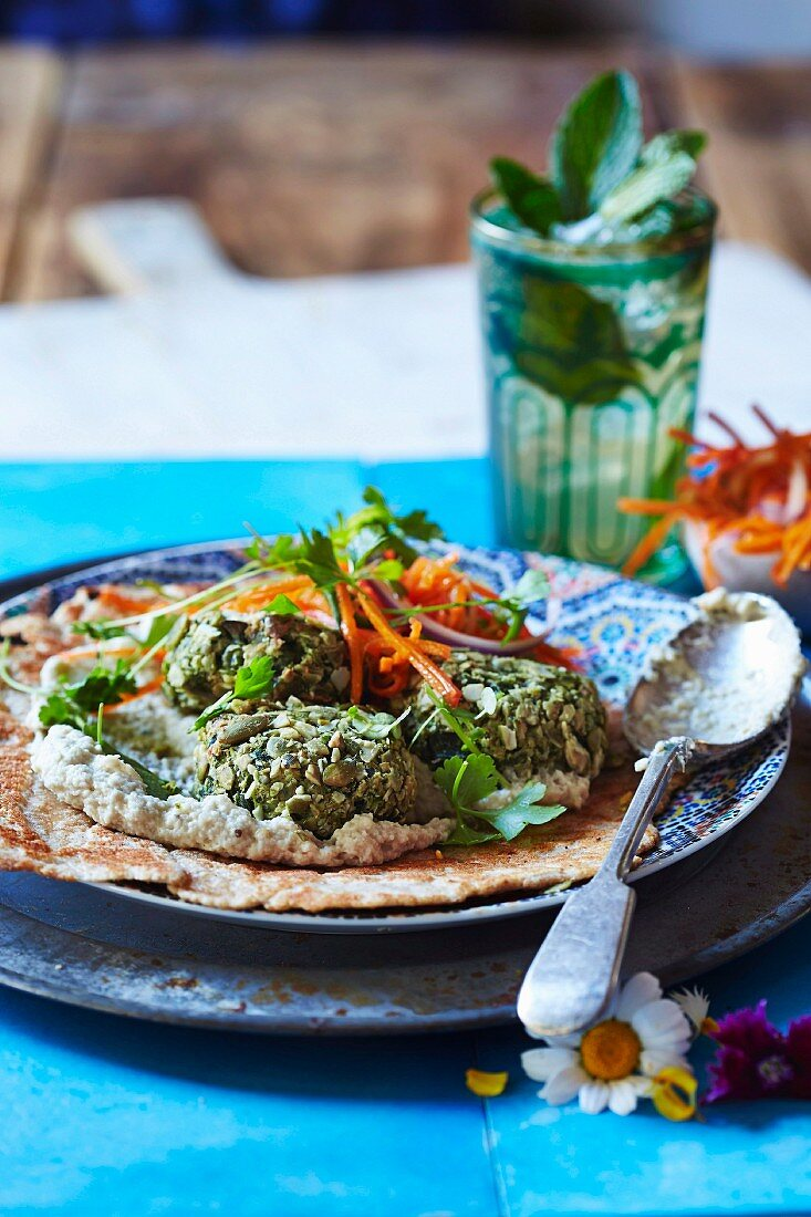 Green falafel with baba ganoush and carrot goji berry salad