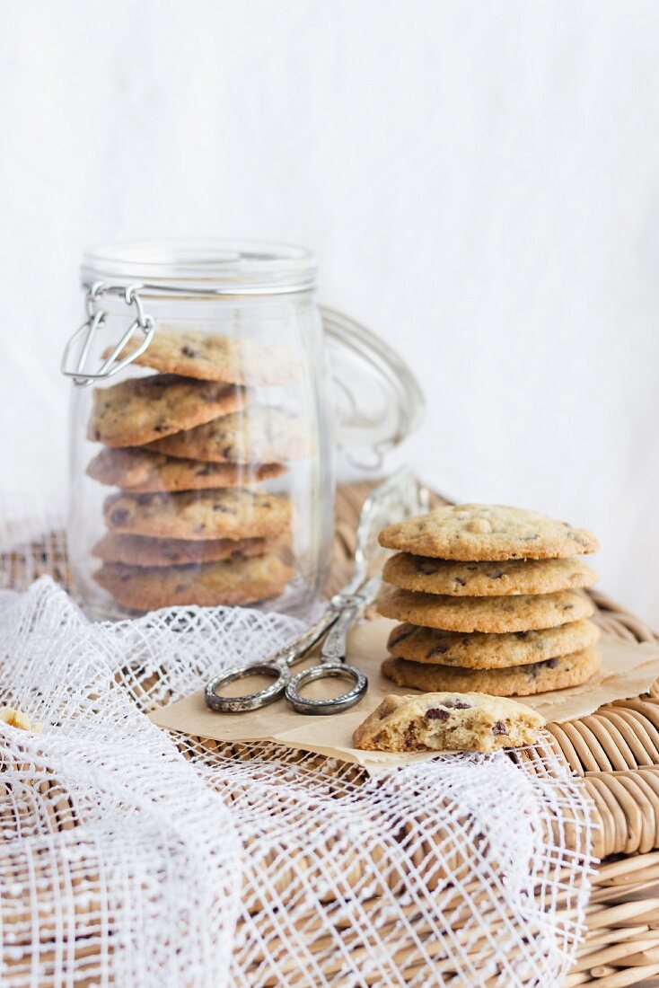 Chocoöate chip cookies in a storage jar and next to it