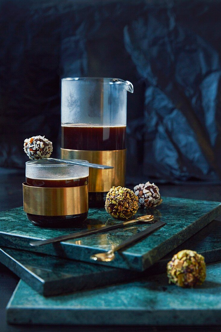Date confectionery with nuts and coconut nibs