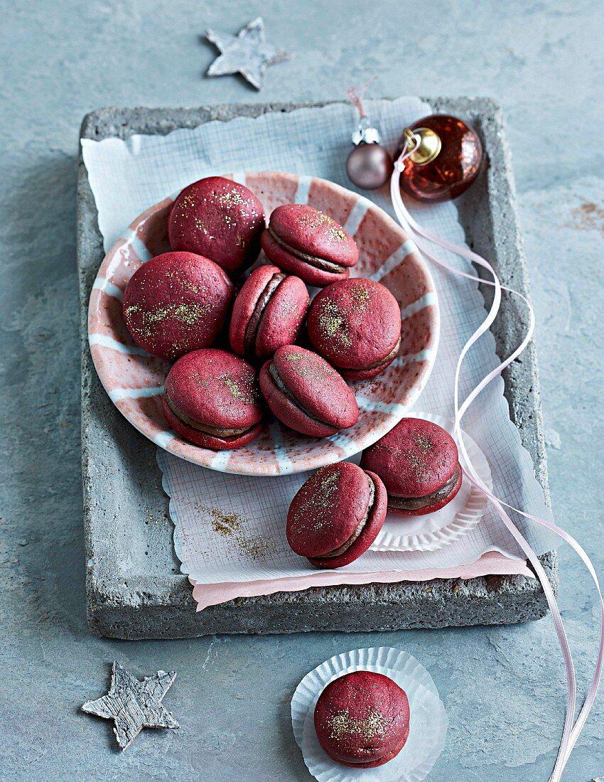 Red velvet macarons with cream filling for Christmas