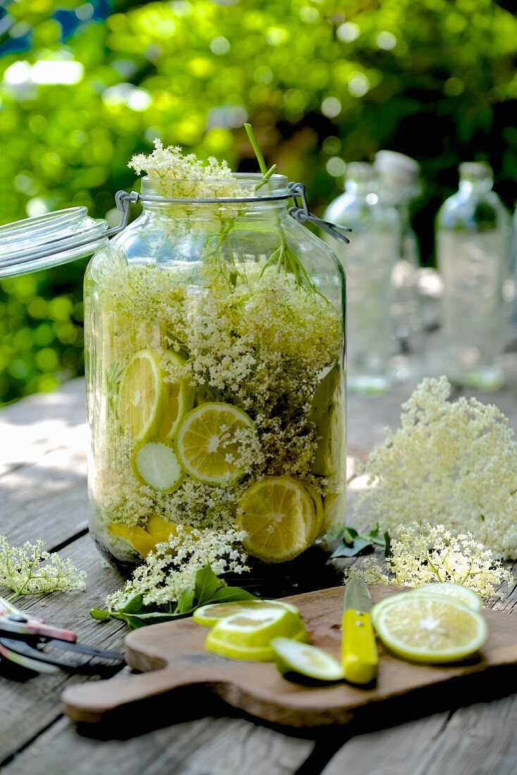 Homemade elderflower syrup with lime in a flip-top glass jar