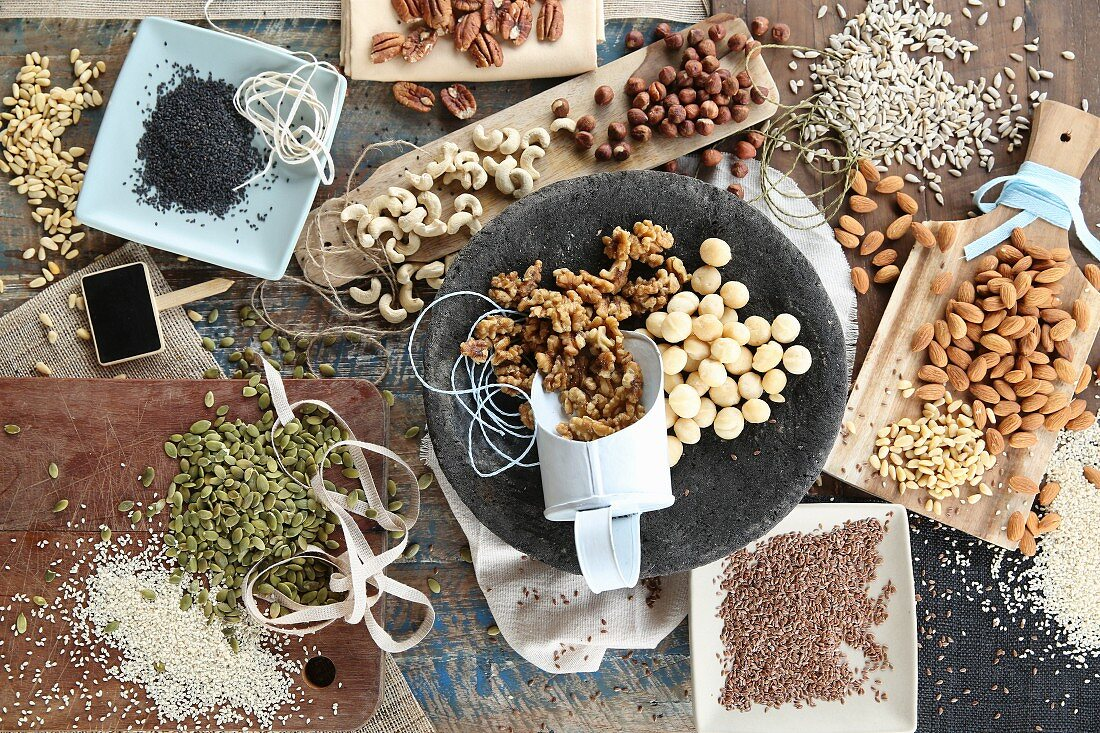 An arrangement of different nuts, seeds and kernels for a vegan diet
