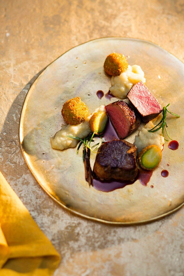 Fillet of venison with Brussel sprouts in a nut coating