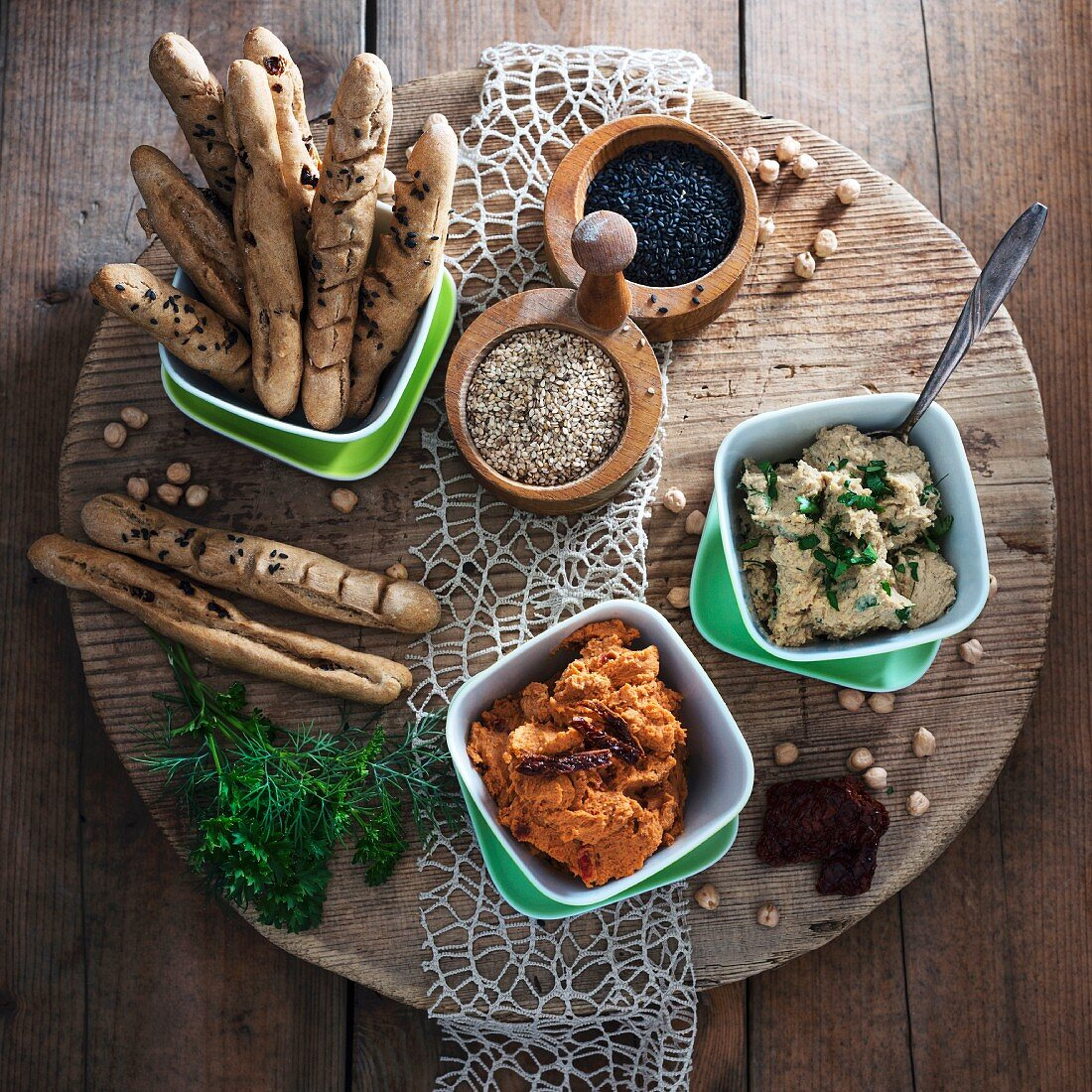 Vegan herb hummus and tomato hummus with sesame sticks