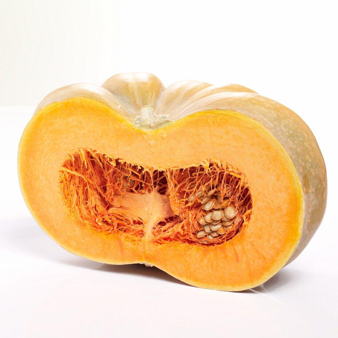 A Muscat pumpkin cut in half